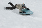 Sporty tobogganing downhill